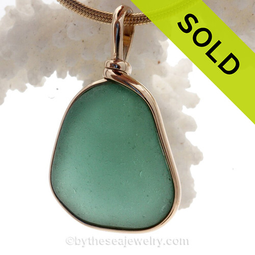 This is a LARGE Stunning Deep Aqua Green Genuine Sea Glass set in our Original Wire Bezel© pendant setting in 14K Rolled Gold.