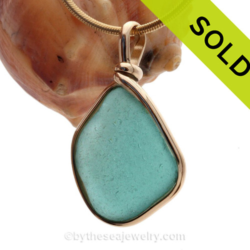 A Stunning Deep Aqua Blue Genuine Sea Glass set in our Original Wire Bezel© pendant setting in 14K Rolled Gold.