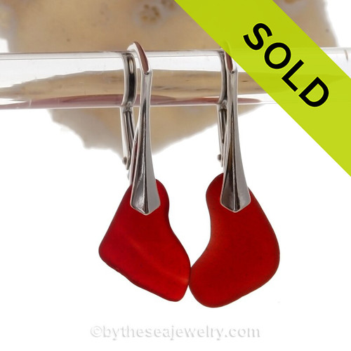 Cool Organic shaped Ruby Red Natural Sea Glass pieces really glow hanging from these solid sterling silver leverback earrings.
