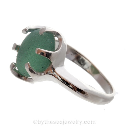 Amazing sea glass from Seaham England in a solid sterling ring in a pure deep sea green or aqua green.