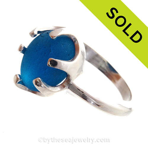 A stunning piece of Victorian Era Glowing  Royal Blue sea glass set in a secure solid sterling prong ring.