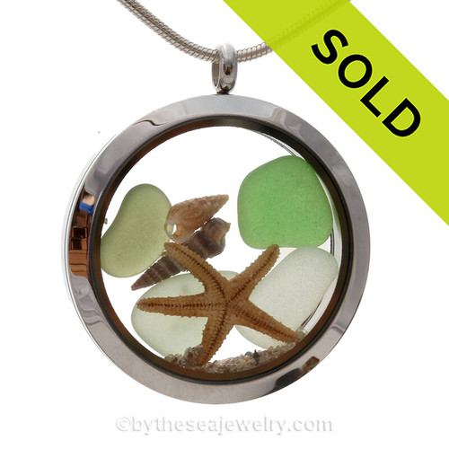 Genuine green and seafoam beach found sea glass pieces combined with a real starfish and tiny shell in this JUMBO 35MM stainless steel locket.