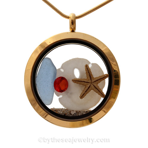 Cornflower Blue Beach Found Sea Glass Goldtone Locket Necklace W/ a real baby sandollar and starfish and a glowing red crystal gem.