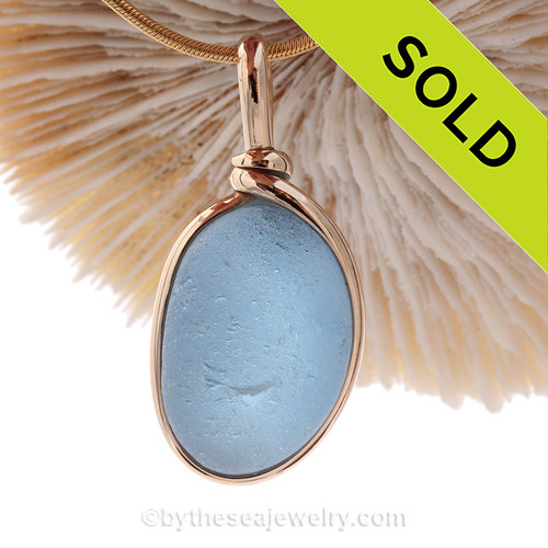 This is a stunning piece of thicker vibrant bright blue EndODay sea glass set in our Original Wire Bezel© pendant setting in gold. Classic and timeless