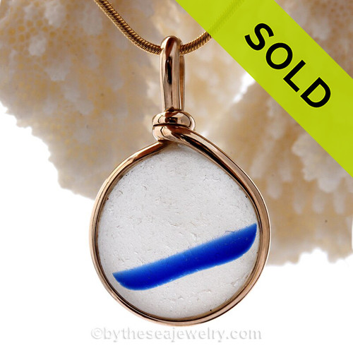 A beautiful almost perfectly round piece of vivid blue and white mixed sea glass set for a necklace in our Original Sea Glass Bezel© in solid sterling silver setting.