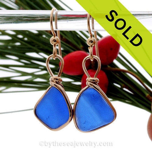 A beautiful vivid blue ridged sea glass pieces set in a gold bezel setting