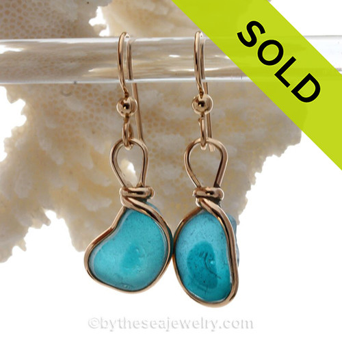 SUPER ULTRA RARE Mixed Electric Aqua Sea Glass Earrings set in our Original Wire Bezel© setting In 14K Goldfilled. This setting leaves the sea glass totally UNALTERED from the way it was found on the beach letting these amazing rare sea glass pieces really shine!   SOLD - Sorry this Sea Glass Jewelry selection is NO LONGER AVAILABLE!