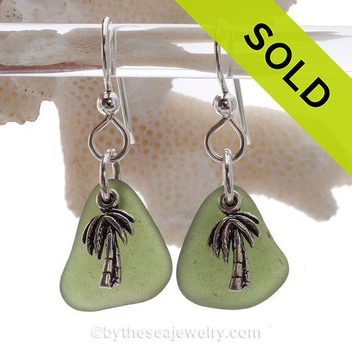 Great pieces of top quality sea glass in green on a secure simple sterling setting combined with solid sterling palm trees.