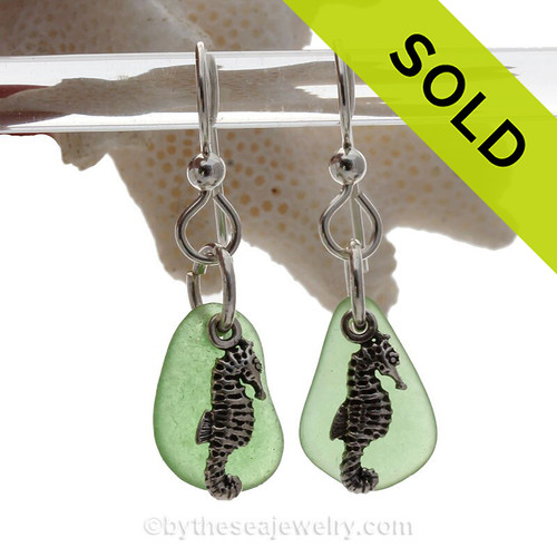 Natural  green sea glass pieces are set with solid sterling seahorse charms and are presented on sterling silver fishook earrings.