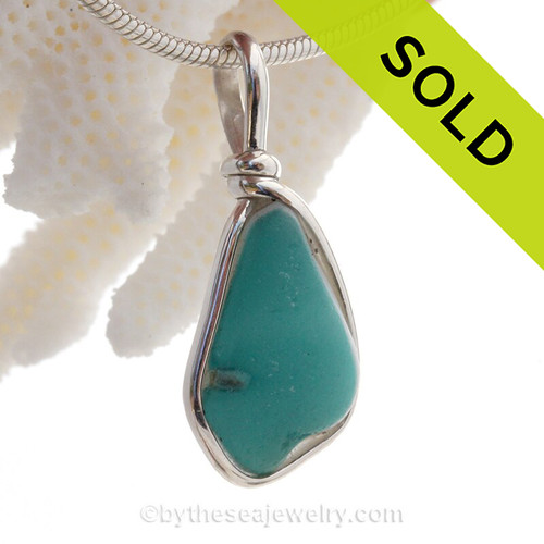 A Lovely Petite Flashed Electric Opaque Aqua & Milk Glass set in Sold Sterling Silver Deluxe Wire Bezel© pendant setting.