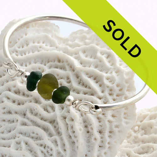 This sea glass bracelet with genuine green sea glass pieces has been sold!