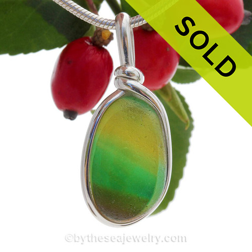 A stunning combination of vivid mixed vivid green with a touch of bright gold in this very old English Sea Glass piece and set in our Original Wire Bezel© necklace pendant setting ins Solid Sterling Silver.
