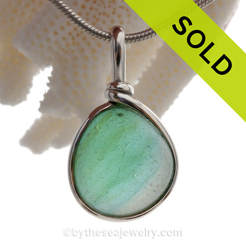 Soft hues of green and Aqua blue mixed sea glass  this almost perfectly round gemball and set in our Original Sea Glass Bezel© in solid sterling silver setting.