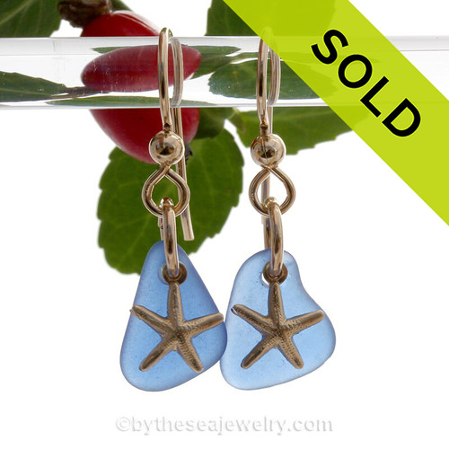 Perfect cobalt blue sea glass pieces set with goldfilled starfish charms for a lovely lightweight pair of sea glass earrings.