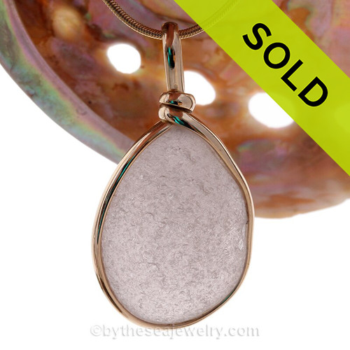 A LARGE and PERFECT top quality purple or lavender sea glass from Maine in our Original Wire Bezel Pendant Setting© that leaves the sea glass UNALTERED from the way it was found on the beach.