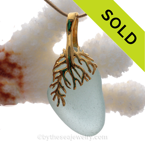 A lovely piece of soft aqua blue sea glass on a nautical 24K gold Vermeil (gold on silver) necklace.