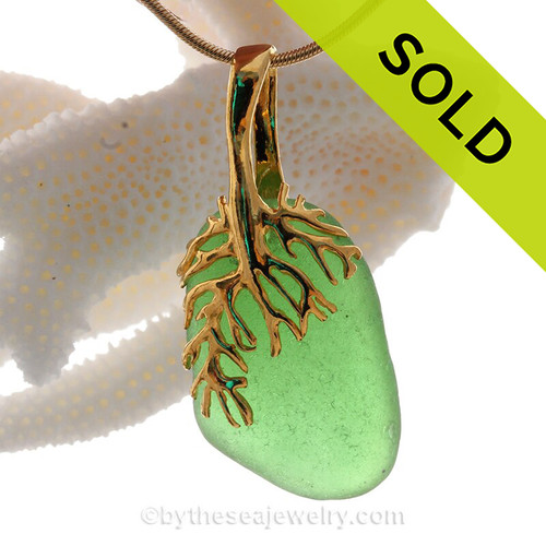 A nice piece of vibrant green sea glass on a nautical 24K gold Vermeil (gold on silver) necklace.