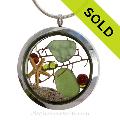 Seaweed Green sea glass is combined with a real starfish and vivid ruby red  and holly green gemstones for a holiday inspired sea glass locket. Celebrate Christmas the sea glass lovers way! Makes a great holiday hostess gift!