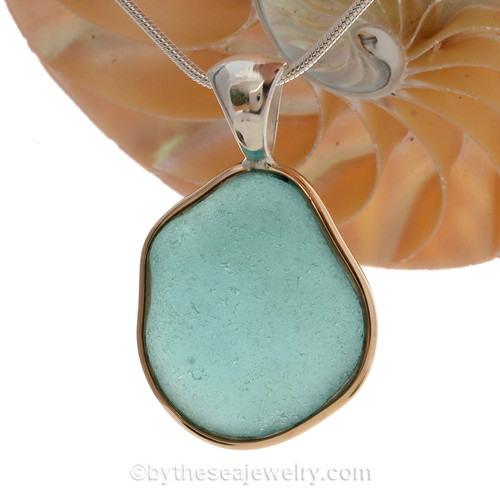 Large Vibrant Aqua Blue Genuine Sea Glass set in our Mixed Deluxe Tiffany Wire Bezel© pendant setting .