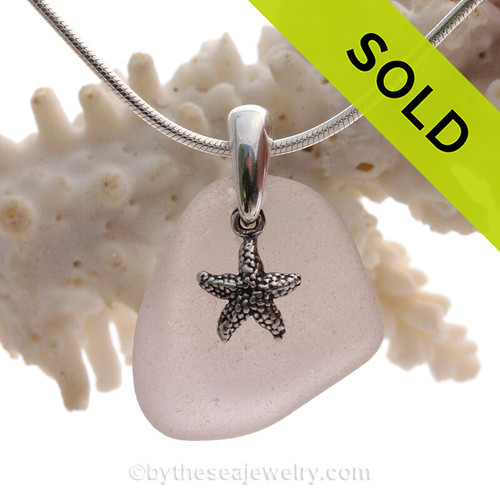 A perfect piece of Pale Purple Certified Genuine Sea Glass in a sterling necklace with a starfish charm. Solid Sterling professionally hand cast bail. Stunning Purple Sun Glass from the Island of Betsy Wyeth in Maine.