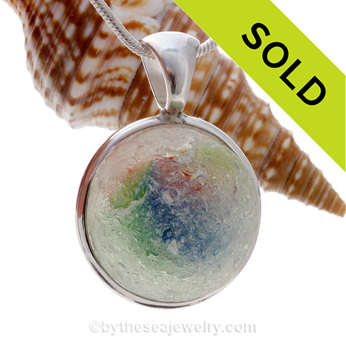 WOW is all you can say when you see the JUMBO Fiesta/Christmas beach found sea glass marble in a deluxe bezel By The Sea Jewelry piece.