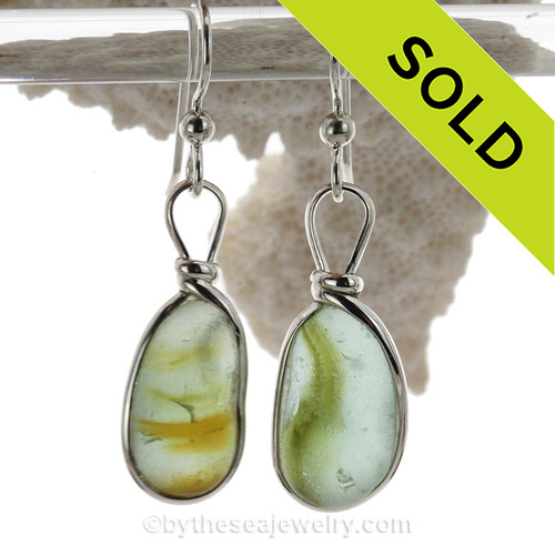 An ultra rare match of mixed vivid mixed green English sea glass piece from Seaham England in our Original Solid Sterling Silver Wire Bezel© sea glass earring setting.