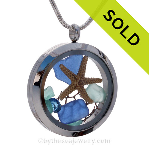 Beautiful pieces of natural Cobalt Blue sea glass combined in a stainless steel locket necklace with a real starfish, a bit of vintage seafan & Sapphire crystal Gems.