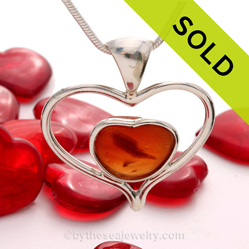 A beautiful small and SUPER RARE Orange Multi color natural sea glass heart set in our deluxe wire bezel pendant setting!