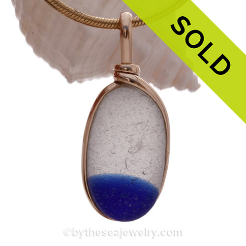 Our Original Wire Bezel© setting leaves this amazing English sea glass piece TOTALLY UNALTERED from the way it was found on the beach. The bezel securely holds the piece and leaves the surface open so that you can reach up and feel the wonderful texture of this top quality sea glass pendant.  SOLD - Sorry this Sea Glass Pendant is NO LONGER AVAILABLE!