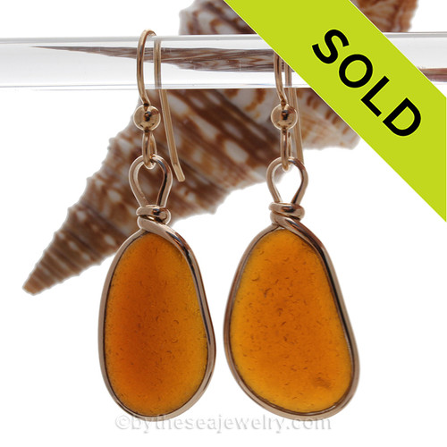 A lovely pair of long and VIVID Amber Brown Genuine Sea Glass Earrings in our Original Bezel Wire© setting in 14K Goldfilled.