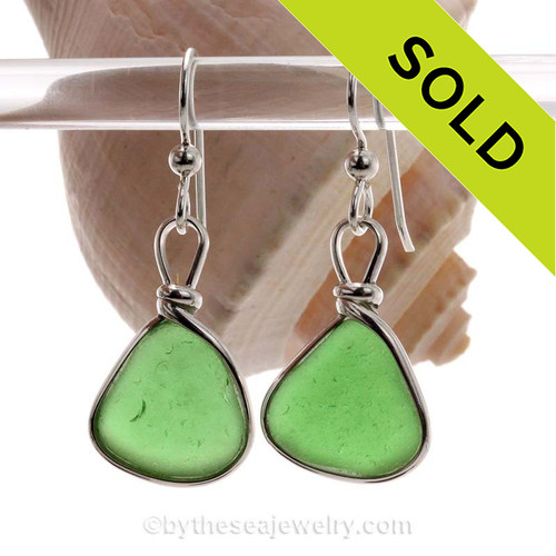Genuine beach found Green Sea Glass Earrings in a Solid Sterling Silver Original Wire Bezel© setting. This is a perfect sea glass in a natural state, just the way it was found on the beach!
