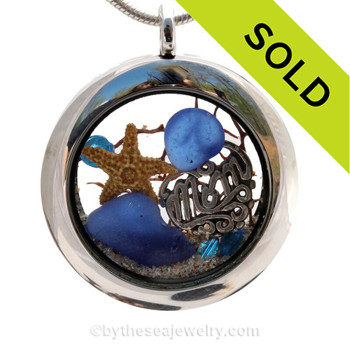 Beautiful  piece of genuine blue sea glass  a real starfish, a bit of vintage sea fan, sapphire crystals and a solid sterling MOM charm completes this sea glass locket necklace.