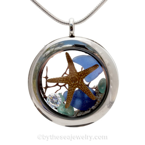 "A Beautiful Vivid Blue Genuine Sea Glass Locket with a real starfish. and beach sand, finished with a vivid brilliant cut CZ gem ""Diamond"" great for any April Beach Baby!"
