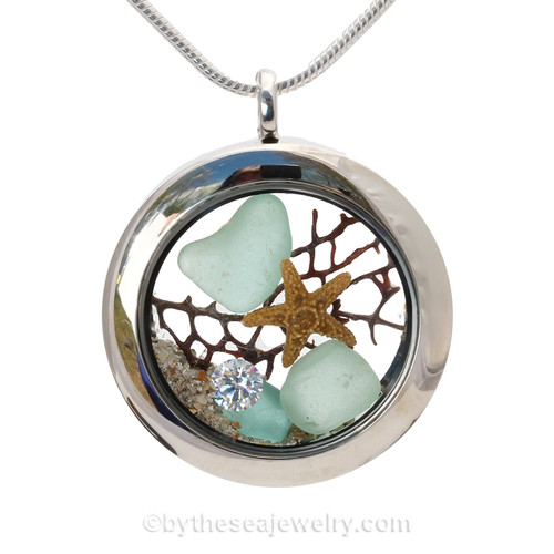 "Beautiful Aqua Blue Genuine Sea Glass Locket with a real starfish and beach sand, finished with a vivid brilliant cut CZ gem ""Diamond"" great for any April Beach Baby!"