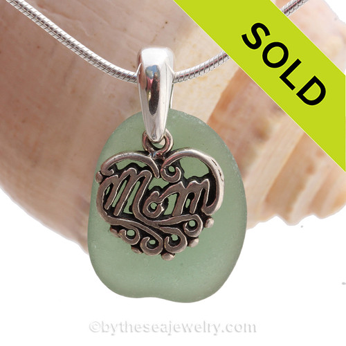 A beautiful piece of Deep Sea Green sea glass on a cast sterling bail with a sterling MOM charm. An 18 inch solid sterling snake chain IS INCLUDED!