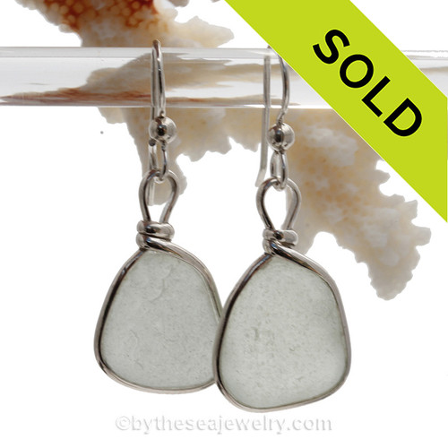 Perfect pieces of white beach found sea glass set in a lovely pair of genuine sea glass earrings in sterling. Our Original Wire Bezel© lets all the beauty of the sea glass shine without altering the glass in any way!