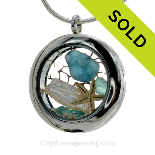 Soft Aqua and Vivid Mid Blue Genuine Sea Glass combined with Real Stick Pearl and baby starfish. Beach sand makes this your own personal beach on the go!