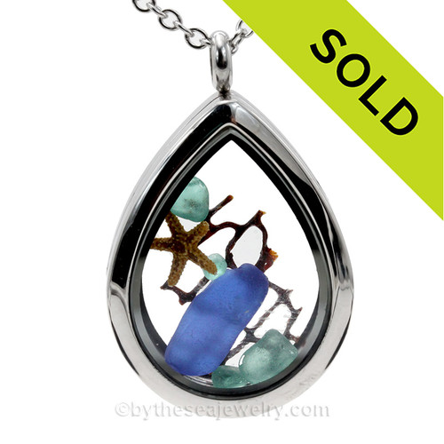 Beautiful  piece of genuine aqua and blue sea glass  a real starfish, a bit of vintage sea fan, in this water drop shaped solid Stainless Steel Magnetic Locket. . A FREE 24 Inch chain is included but Sterling options are available.