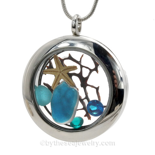Mixed Electric Aqua Seaham Multi combined with a small electric aqua and Finished with vibrant crystal gems and a real baby starfish makes a lovely tropical locket for an y beachlover.