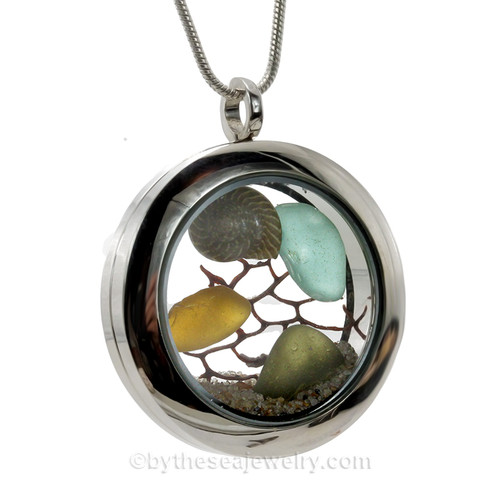 A lovely combo of jeweltone sea glass combined with a small nautilus shells and beach sand make this your own personal beach-on-the-go!