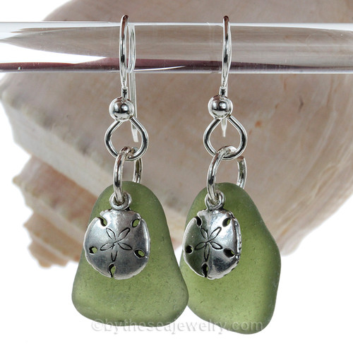 A simple pair of seaweed green Genuine Sea Glass Earrings with sterling beachy Sandollar charms in a lightweight simple setting