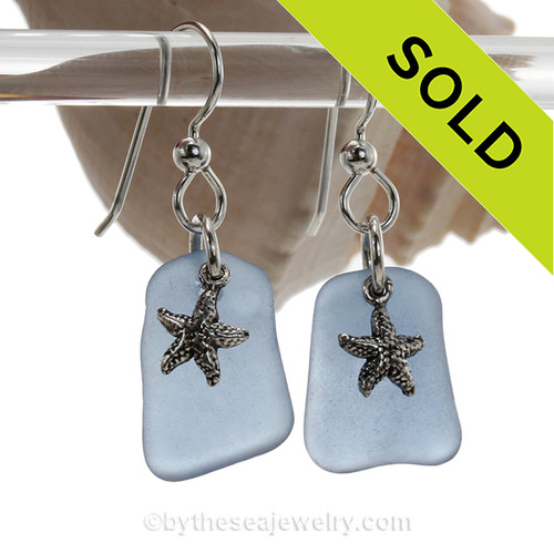 A pair of Natural Beach Found  Carolina Blue Sea Glass Earrings with Solid Sterling Starfish Charms.