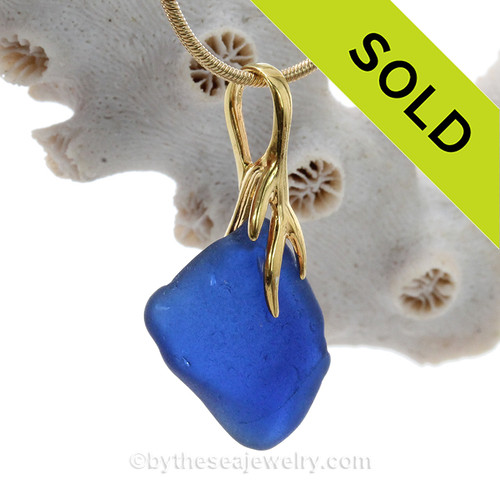 A soft lovely piece Cobalt Blue sea glass on a nautical 24K gold Vermeil (gold on silver) necklace.