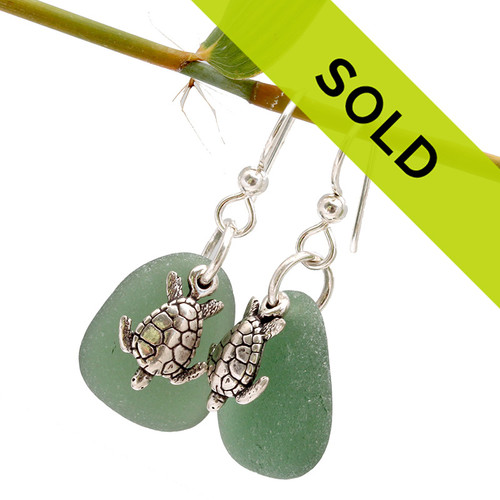 Unusual green sea glass pieces set with solid sterling sea turtles for a lovely pair of sea glass earrings!