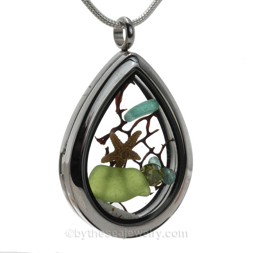 Beautiful  piece of genuine aqua and peridot green sea glass  a real starfish, a bit of vintage sea fan, in this water drop shaped solid Stainless Steel Magnetic Locket.  A Brilliant Peridot Crystal makes this a great gift for any August beach lover. . A FREE chain is included but Sterling options are available.