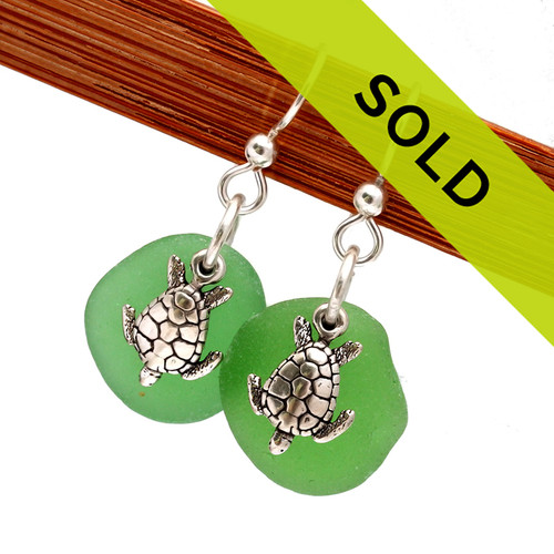 These green genuine sea glass earrings in sterling with sea turtles have been sold!
