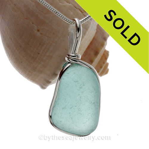 Large and Thick Aqua Blue Genuine Sea Glass set in our Original Wire Bezel© pendant setting in Sterling Silver .