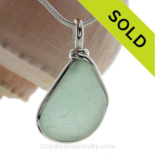 Pale Aqua or Seafoam Green Genuine Sea Glass set in our Original Wire Bezel© pendant setting in Sterling Silver.