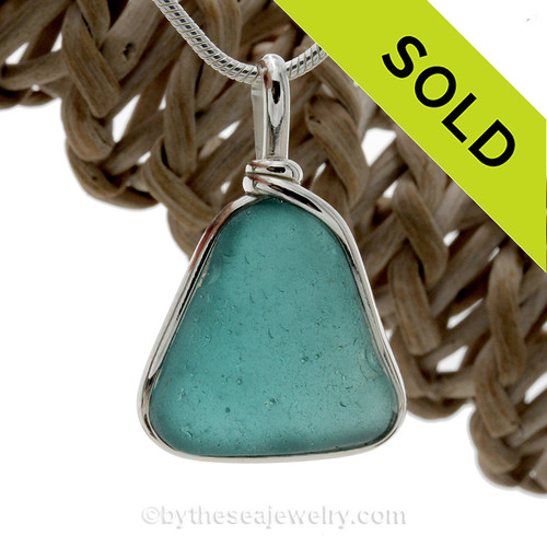Stunning and Unusual Vivid Blue Aqua Sea Glass set in our Original Wire Bezel© pendant setting in Sterling Silver