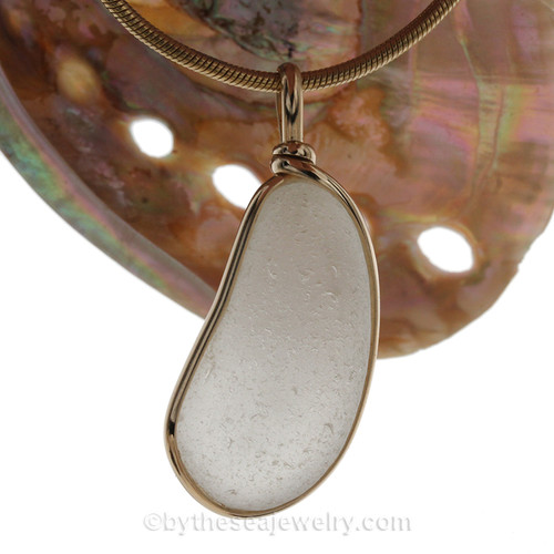 A large and lovely thick pure white sea glass set in our Original Wire Bezel© pendant setting with 14K rolled gold.